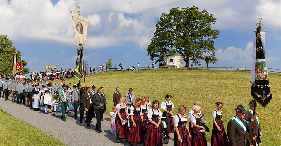 traditional costumes and flags during Corpus Christi procession