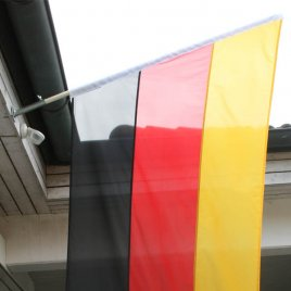 Germany flag as oblique flag on wall attachment