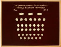 Donation board of the fire brigade of Knippelsdorf on red velvet for the flag of 2012
