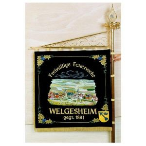 Elaborately embroidered home side with big picture of the municipality of Welgesheim