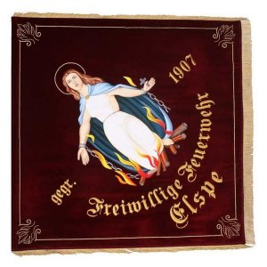 The firebrigade flag of Elspe with figure of saint and flames