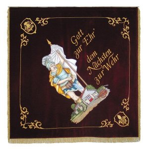 Modern writing besides figure of Saint Florian on the home side of the firebrigade flag