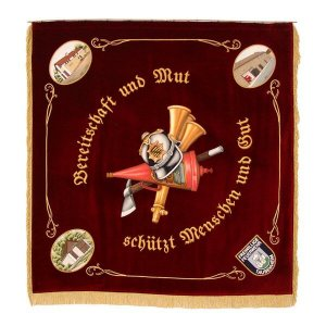 Elaborately embroidered corner motives with fire fighter gadgets