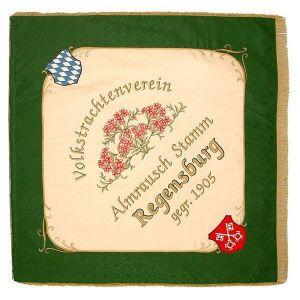 Almrausch folk dance club with ressembling flower center motive