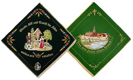 Picture of the back and the front side of the club flag of a homeland and traditional costume club